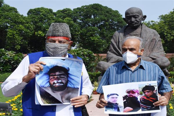 NC MPs protest Fake encounter, custodial killing at Parliament
